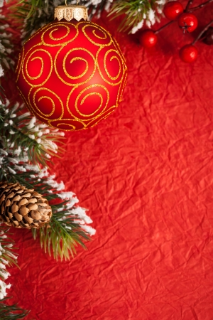 Border from Christmas tree decorations on red paper photo
