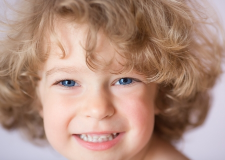 blue eyes: Closeup portrait of the beautiful girl with healthy curly hair and blue eyes