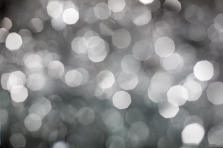 боке: Аннотация рождественские огни фоне серебро