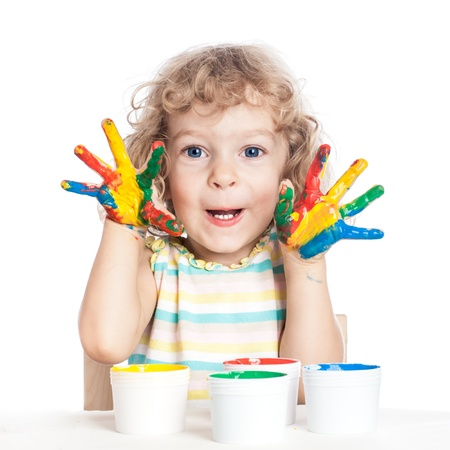 Funny baby holding hands painted in finger paints