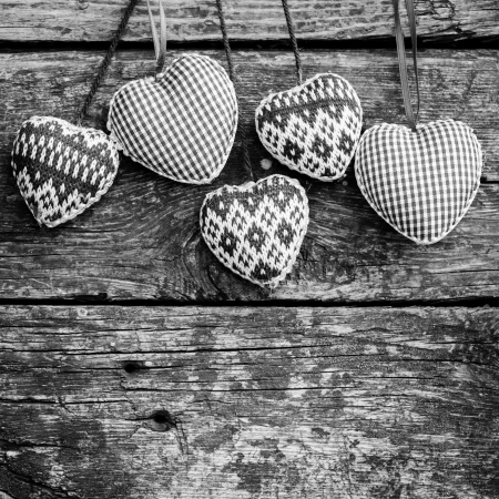 Hearts on wooden background  Valentine s day concept  Black and white photo