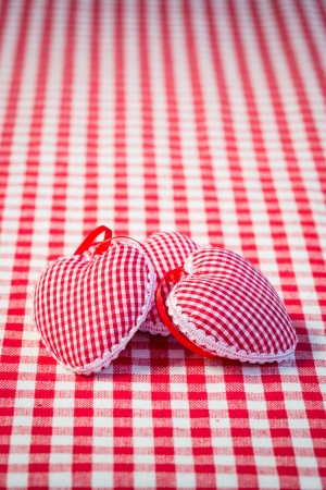 abstract love: Three red hearts on gingham tablecloth  Mother s day concept Stock Photo