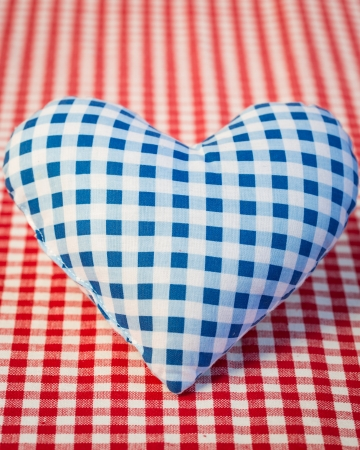 Big blue heart on gingham tablecloth  Father s day concept photo