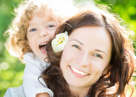 family day: Happy woman and child in spring park  Stock Photo