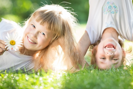 Happy children playing outdoors in spring park Stock Photo