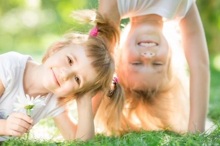 Happy children playing outdoors in spring park Stock Photo - 17329469