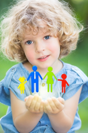 Happy family in children`s hands Stock Photo - 17500550