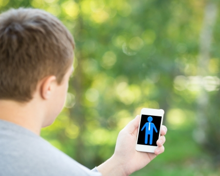 Man holding smartphone in hand outdoors  Communication concept Stock Photo - 17546794