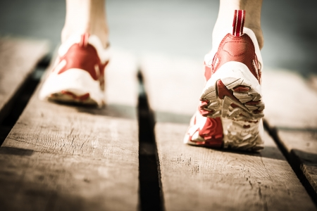 Feet of jogging person  Healthy lifestyle concept photo