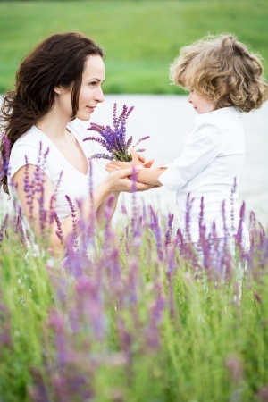 Happy child with mother in lavender field photo