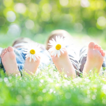 active couple: Active couple lying on grass in spring park against natural green background Stock Photo