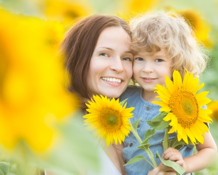 happy family nature: Happy family with beautiful sunflowers in spring field