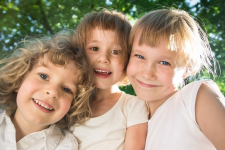 Low angle view closeup portrait of happy friends in spring park Stock Photo - 18347196