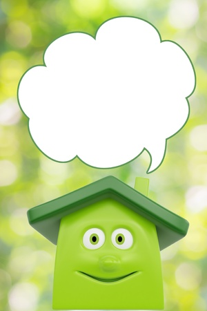 Eco green cartoon house with speech bubble blank. Ecology concept photo