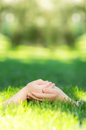 lifestyle outdoors: Empty hands on green grass  Ecology concept Stock Photo