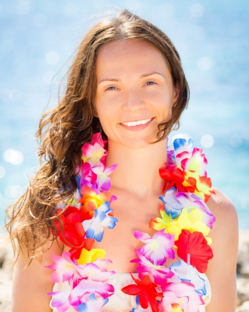 hawaiian lei: Happy smiling woman with hawaiian flowers garland on the beach. Summer vacations concept