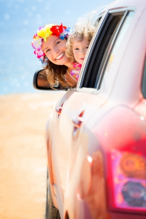 Happy family car trip on summer vacation. Travel concept photo