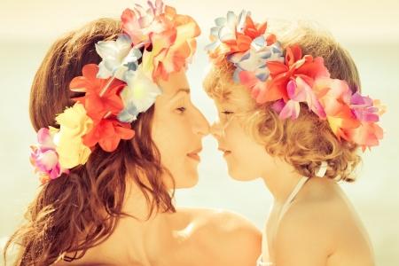 vacation: Woman and child wearing hawaiian flowers