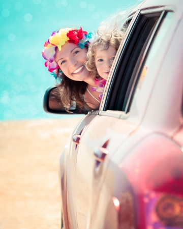 Happy family car trip on summer vacation photo