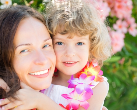 sea flowers: Happy child embraced your mother outdoors. Summer vacations Stock Photo