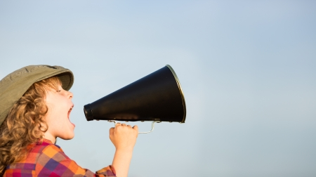 publicity: Kid shouting through vintage megaphone