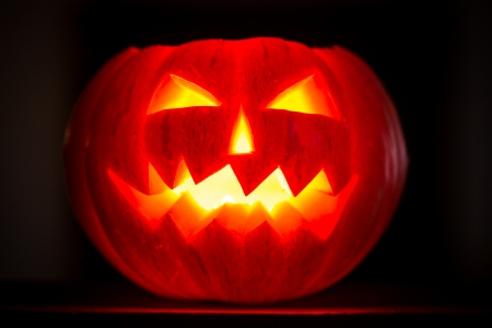 Scary halloween pumpkins jack-o-lantern candle lit  Autumn holidays concept photo