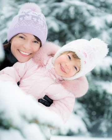 Happy family playing in winter outdoors photo
