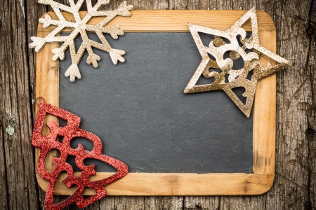 Christmas tree decorations on vintage wooden blackboard  Winter holidays concept  Copy space for your text photo