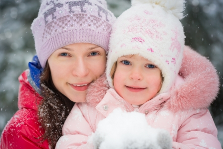 Happy family in winter outdoors photo