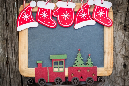 Christmas tree decorations border on vintage wooden blackboard  Winter holidays concept  Copy space for your text photo