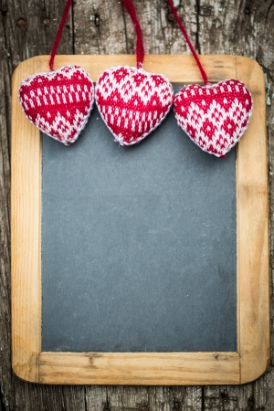 Christmas tree decorations border on vintage wooden blackboard. Winter holidays concept. Copy space for your text photo