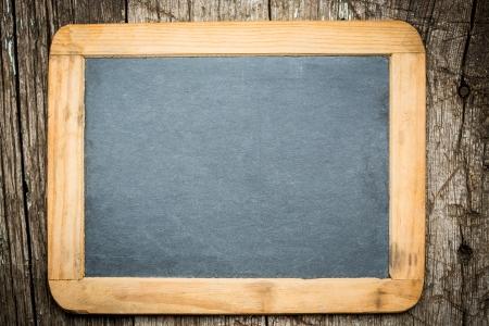 Vintage blackboard on wooden background Stock Photo - 22918306