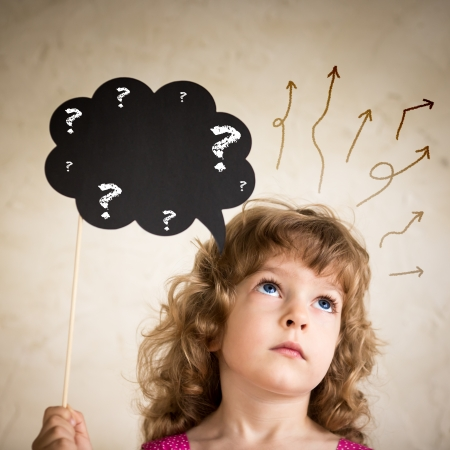 thought cloud: Confused child with paper cloud