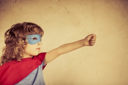 superhero: Superhero kid against grunge concrete background
