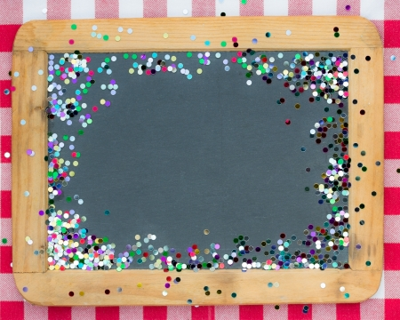 tablecloth: Vintage wooden blackboard with confetti on red gingham tablecloth  Winter holidays concept  Copy space for your text