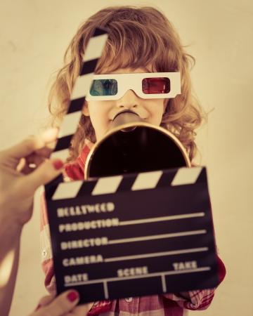 clapper board: Kid holding clapper board in hands. Cinema concept. Retro style Stock Photo