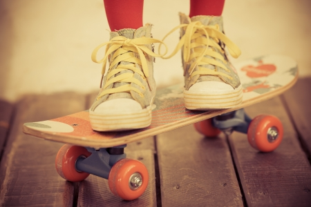 Legs of skateboarder. Closeup view Stock Photo