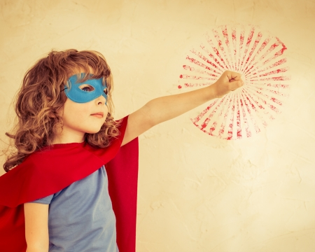 Superhero kid against grunge wall background photo