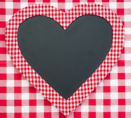 gingham: Blackboard in heart shape on red gingham tablecloth  Valentine s day concept Stock Photo