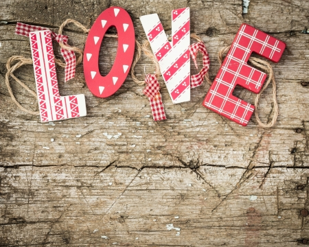 red gingham: Handmade letters L O V E on wood  Valentine s day concept