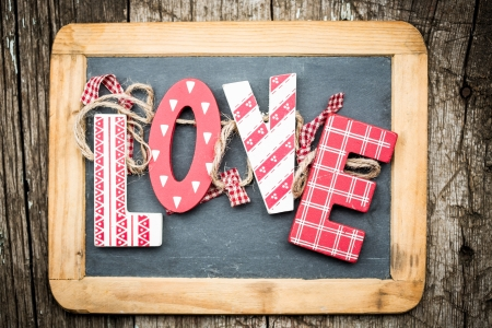 red gingham: Handmade vintage letters L O V E on wooden blackboard  Valentine s day concept