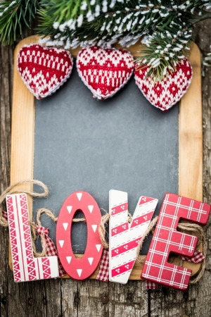 Handmade vintage letters L O V E on wooden blackboard  Valentine s day concept photo