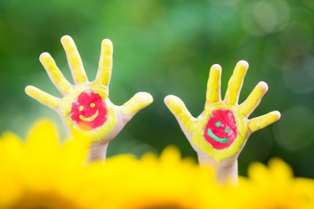 Smiley hands against green spring background photo