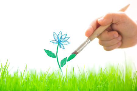 Drawing flower over spring green grass photo