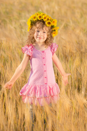 Happy child in wheat field photo