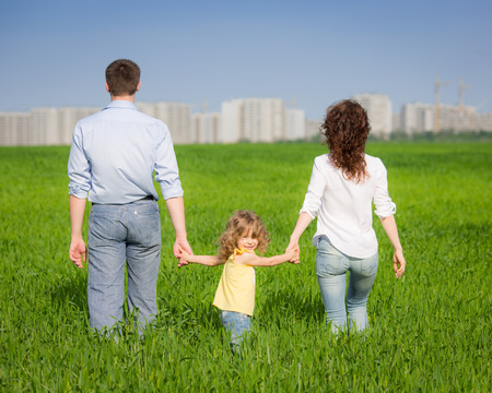 Happy family having fun outdoors in spring field photo