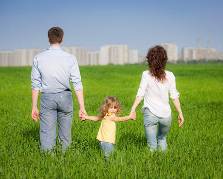 urban environments: Happy family having fun outdoors in spring field Stock Photo
