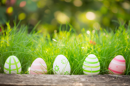 Easter eggs on green grass. Spring holidays concept