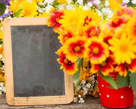 Wooden frame and spring flowers photo