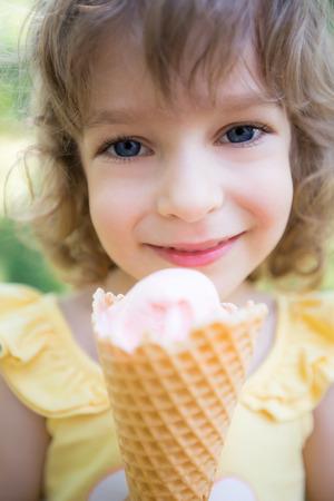child ice cream: Happy child eating ice cream